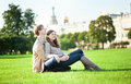 Couple sitting on the grass Stock Photography