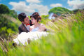 Couple sitting in green grass portrait of romantic teenage Royalty Free Stock Images