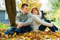 Couple sitting on ground Royalty Free Stock Image