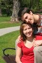 Couple sitting on park bench Stock Image