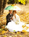 Couple sitting at the park with umbrella Royalty Free Stock Images