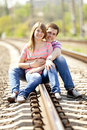Couple sitting at railway. Royalty Free Stock Photo