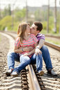 Couple sitting at railway. Stock Photography