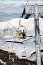 Couple on ski elevator Royalty Free Stock Photo