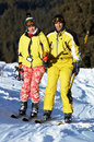 Couple skiers on mountain ski elevator Stock Photos