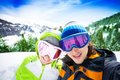 Couple of skiers young with mountains on background Royalty Free Stock Photos
