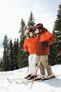Couple on Skis on Mountain Slope Stock Photo