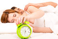 Couple is sleeping and the alarm clock starts to ring time to wake up Stock Photography
