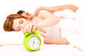 Couple is sleeping and the alarm clock starts to ring time to wake up Stock Photo