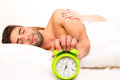 Couple is sleeping and the alarm clock starts to ring time to wake up Royalty Free Stock Images