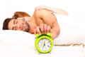 Couple is sleeping and the alarm clock starts to ring time to wake up Stock Images
