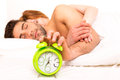 Couple is sleeping and the alarm clock starts to ring time to wake up Royalty Free Stock Photos