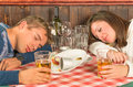 Couple sleeping after a huge alcoholic dinner portrait of pacific Stock Image