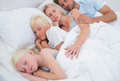 Couple sleeping with their cute children Royalty Free Stock Photo
