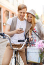 Couple with smartphone and bicycles in the city summer holidays bikes love relationship navigation gps dating concept Stock Images