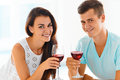 Couple smiling at the camera with red wine. Celebration Royalty Free Stock Photo