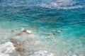 Couple snorkeling in turquoise choppy sea waters of an extraordinary clean and clear water photographed from above travel leisure Royalty Free Stock Images