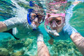 Couple snorkelling underwater photo of a in ocean Royalty Free Stock Image