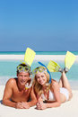 Couple snorkels enjoying beach holiday smiling Royalty Free Stock Photography