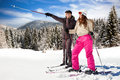 Couple with snow skis young outdoor Royalty Free Stock Photography