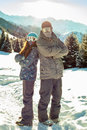Couple snowboarder in place in the mountains
