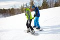 Couple snowboarders young in a ski resort Royalty Free Stock Images
