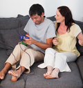 Couple on Sofa Playing Video Games Royalty Free Stock Photography
