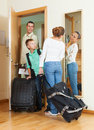 Couple with son with luggage near door teenage Stock Image