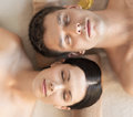 Couple in spa healthcare and beauty concept picture of salon lying on the massage desks Royalty Free Stock Images