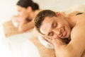 Couple in spa with hot stones picture of salon Stock Image