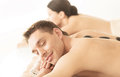 Couple in spa with hot stones picture of salon Royalty Free Stock Photography