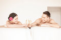 Couple in spa picture of salon drinking champagne Royalty Free Stock Photos