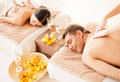 Couple in spa picture of salon getting massage Royalty Free Stock Photos
