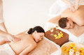 Couple in spa picture of salon getting massage Stock Photos