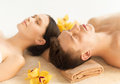 Couple in spa picture of salon lying on the massage desks Royalty Free Stock Photo
