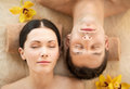 Couple in spa picture of salon lying on the massage desks Royalty Free Stock Photos