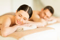 Couple in spa picture of salon lying on the massage desks Stock Images