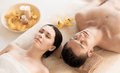 Couple in spa picture of salon lying on the massage desks Stock Photography