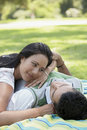 Couple spending leisure time in park young women and men Royalty Free Stock Photos