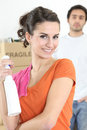 Couple spring cleaning Royalty Free Stock Image
