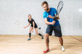 Couple with squash rackets, indoor training club Royalty Free Stock Photo