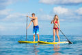 Couple stand up paddling in hawaii attractive Royalty Free Stock Images