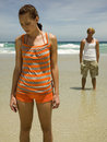 Couple standing away from each other at the beach Royalty Free Stock Photography
