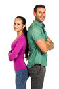 Couple standing back to back and smiling at the camera on white screen Royalty Free Stock Image