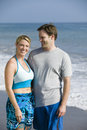 Couple standing on beach portrait Royalty Free Stock Image