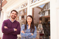 Couple standing in front of a shop window Royalty Free Stock Photo