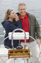 Couple Standing By Helm On Sailboat Royalty Free Stock Photo