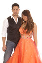 Couple standing orange formal a men and women together she is in her dress Stock Photos
