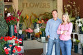Couple standing outside florist Stock Photos