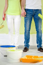 Couple standing with painting tools young Royalty Free Stock Images